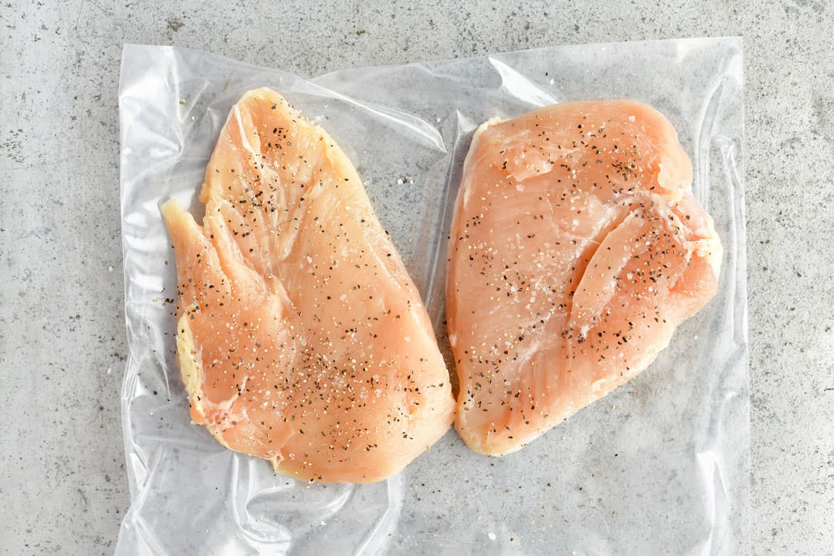 two seasoned boneless skinless chicken breasts