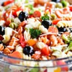 Italian pasta salad in a clear glass bowl