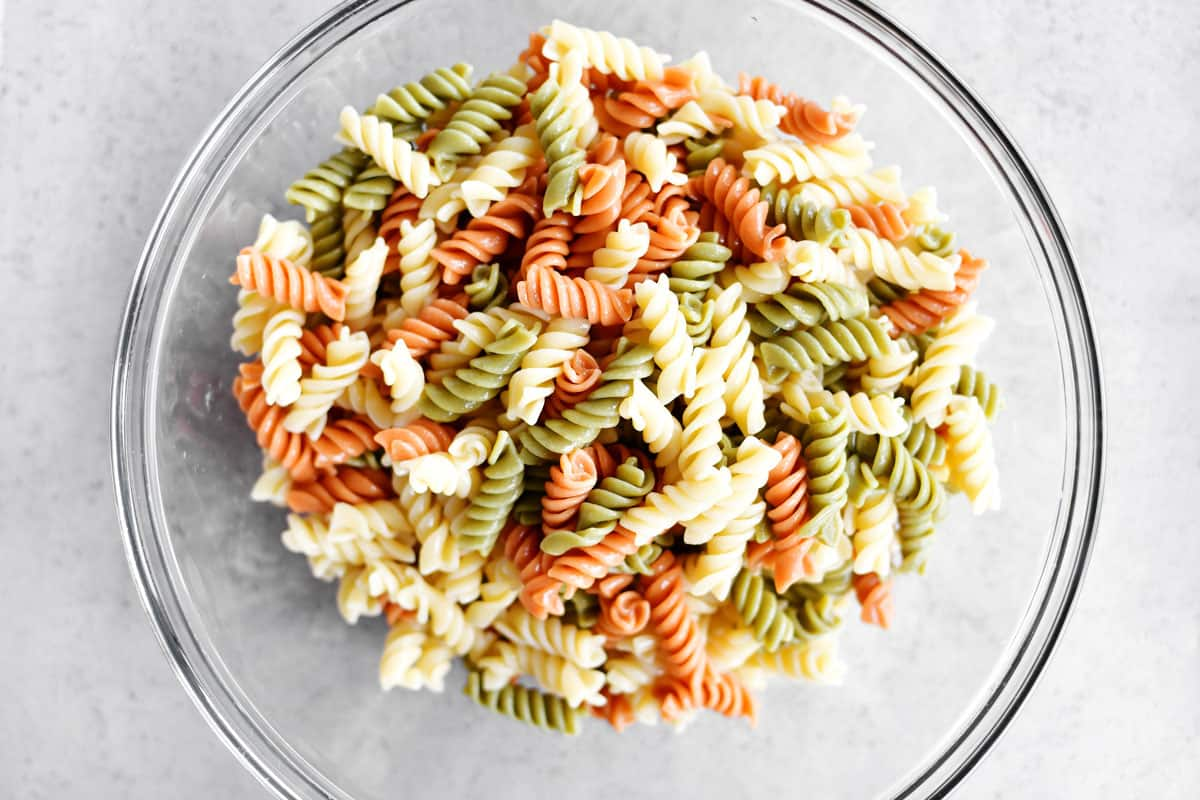 cooked tricolor rotini in a bowl