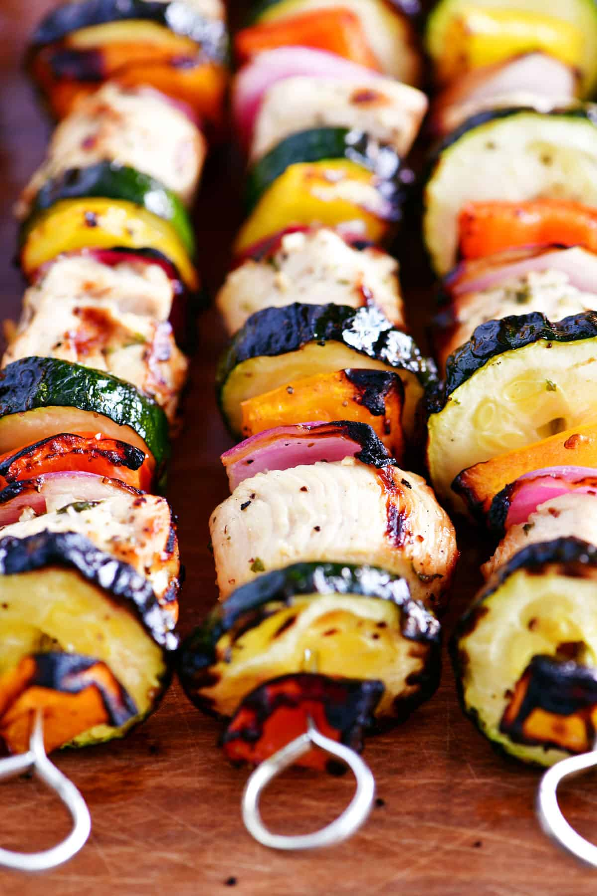 grilled garlic herb chicken kabobs with peppers onions and zucchini
