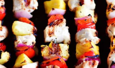 five cooked mango chicken kabobs