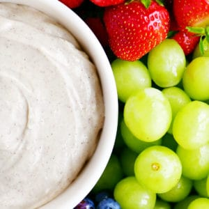 fruit dips in a bowl with grapes, blueberries and strawberries