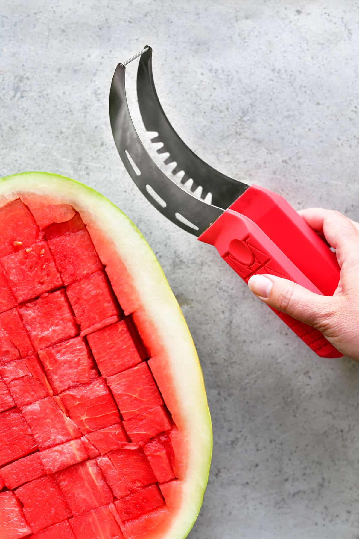 watermelon slicer tongs and a sliced watermelon