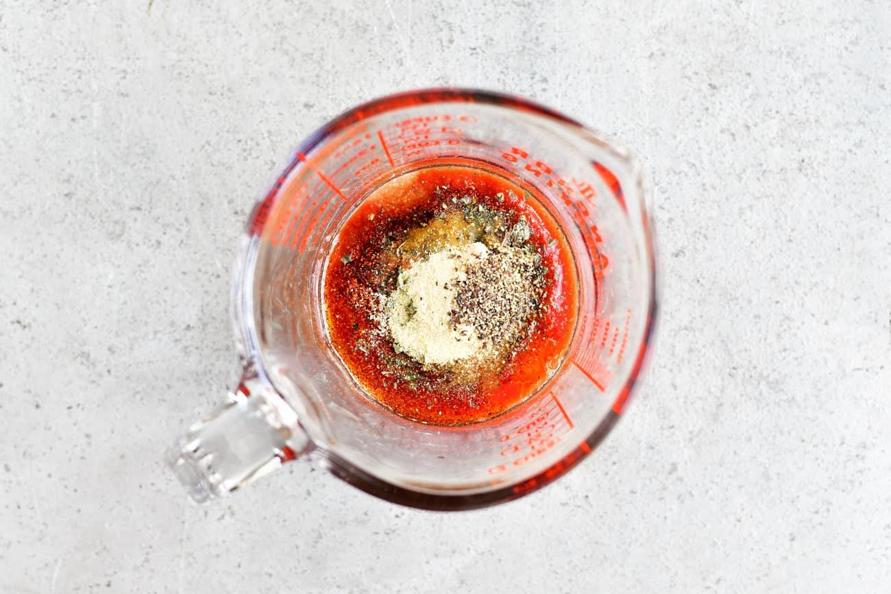seasonings in a glass measuring cup