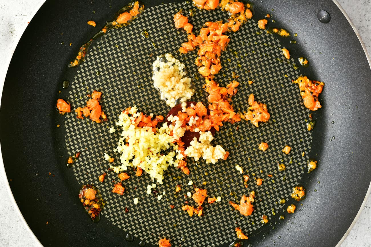 minced carrots, garlic and ginger in a saute pan
