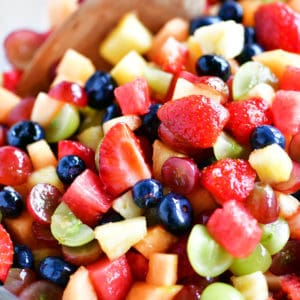 fruit salad in bowl with spoon