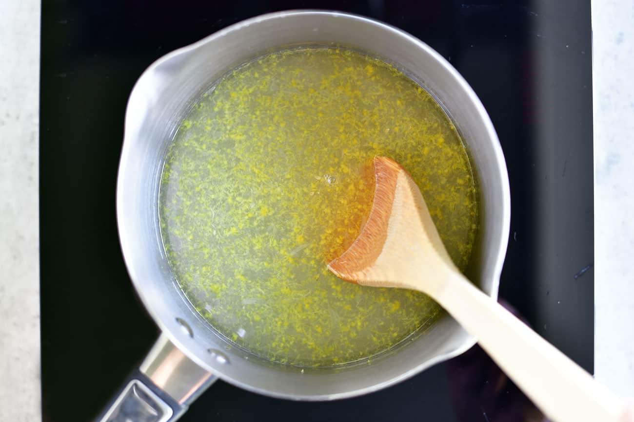 boiling lemon vanilla glaze in saucepan