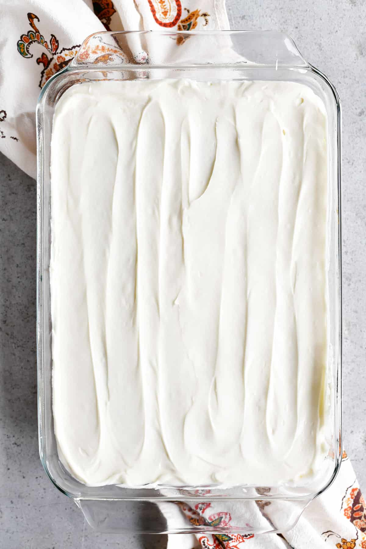frosted cake in pan