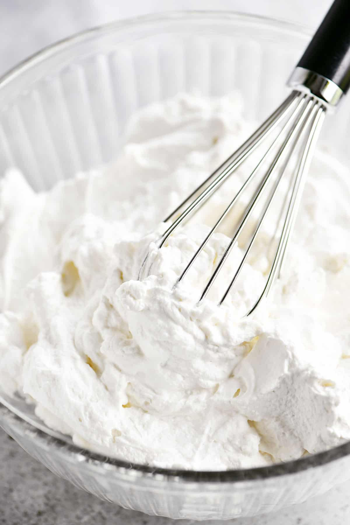 whisk in bowl of cream
