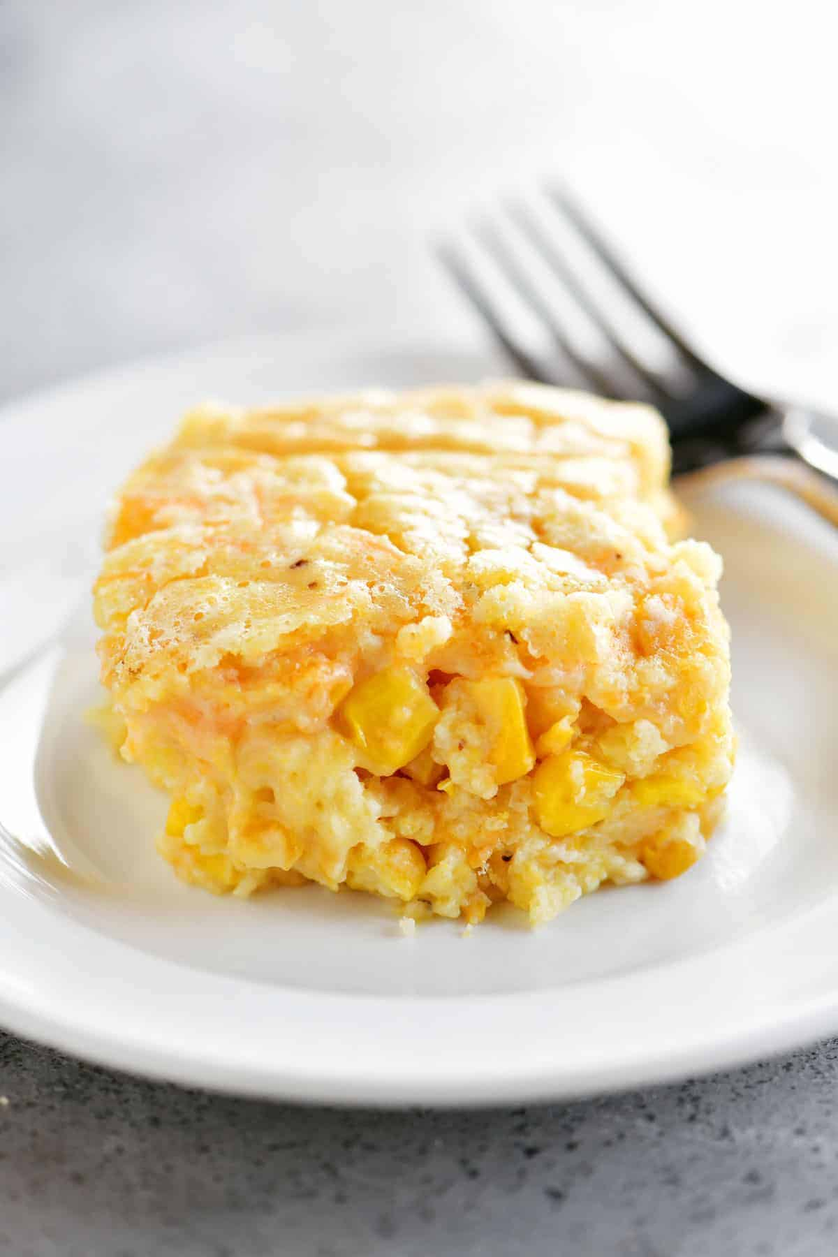 slice of corn casserole on a white plate