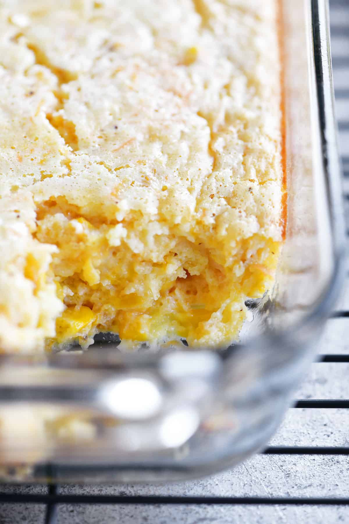 corn casserole in pan with a slice removed