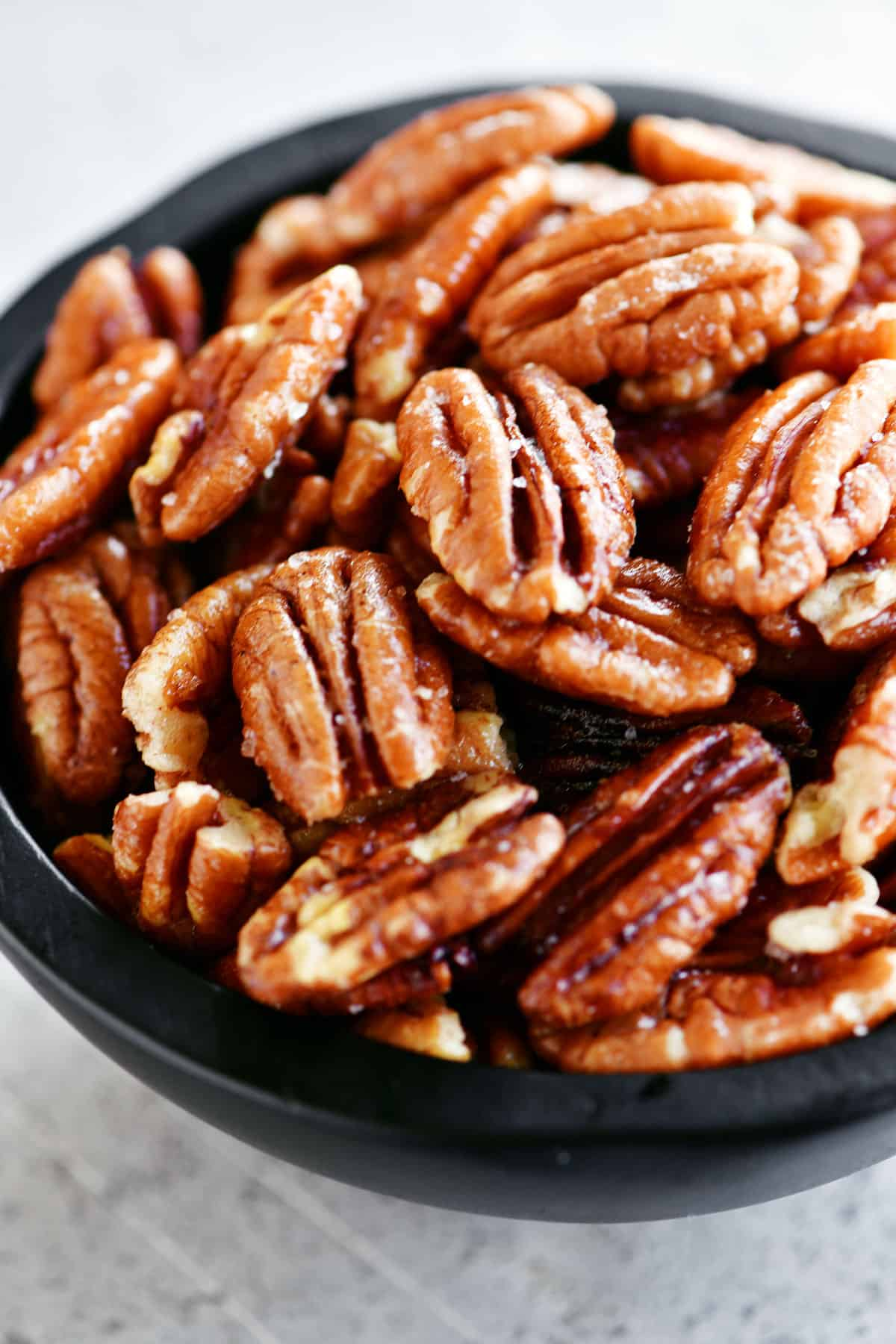 black bowl of pecans