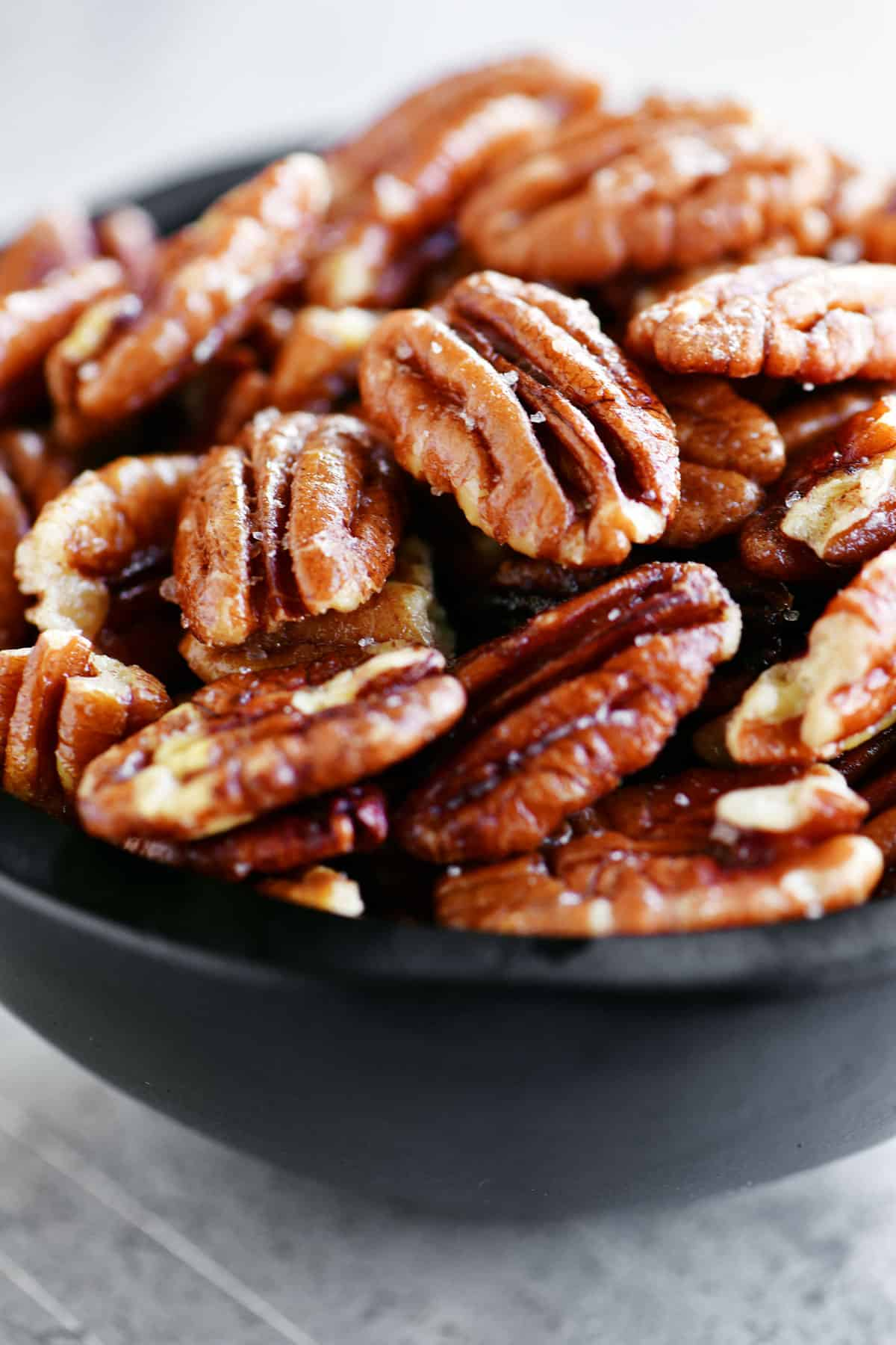 pecans in a black bowl