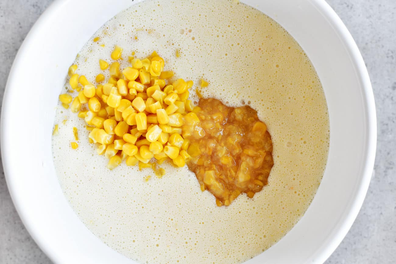 sweet corn and creamy style corn added to bowl