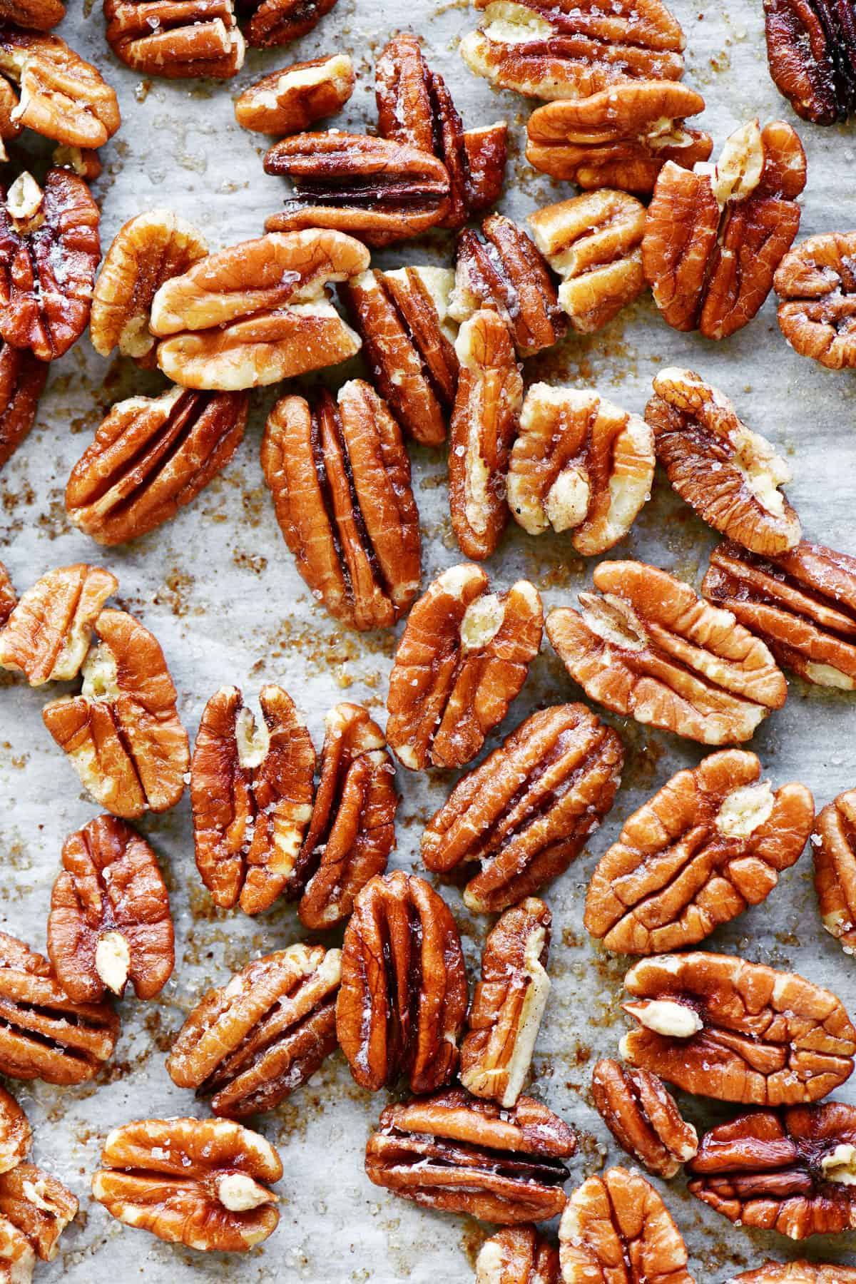 toasted pecans on parchment paper