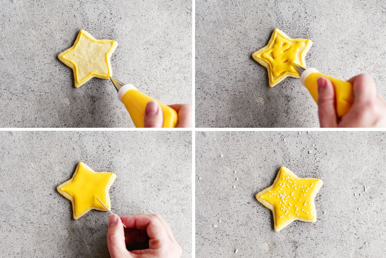decorating a sugar cookie star with icing