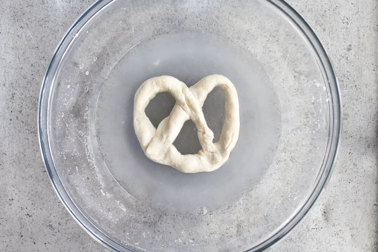 soft pretzel dough in baking soda bath