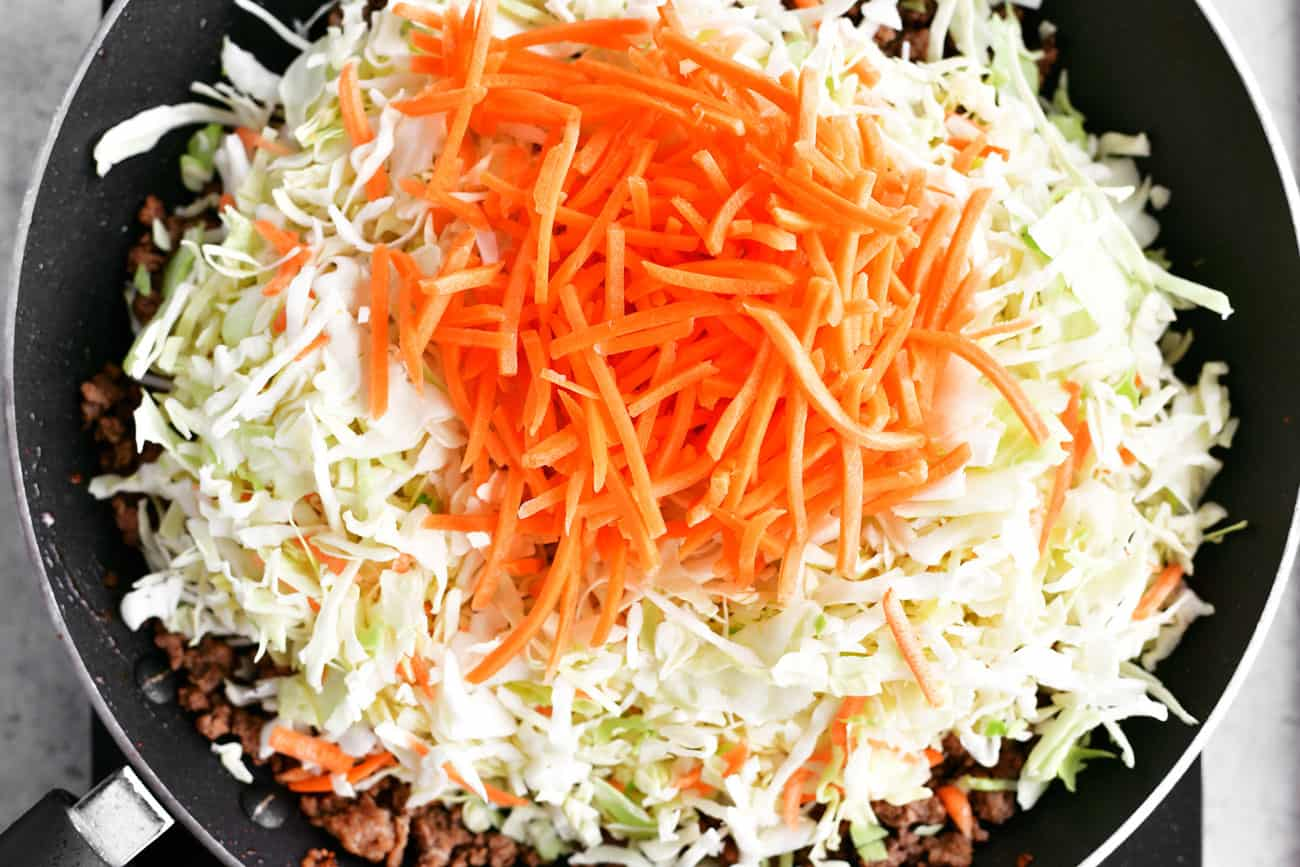 shredded cabbage and carrots in skillet