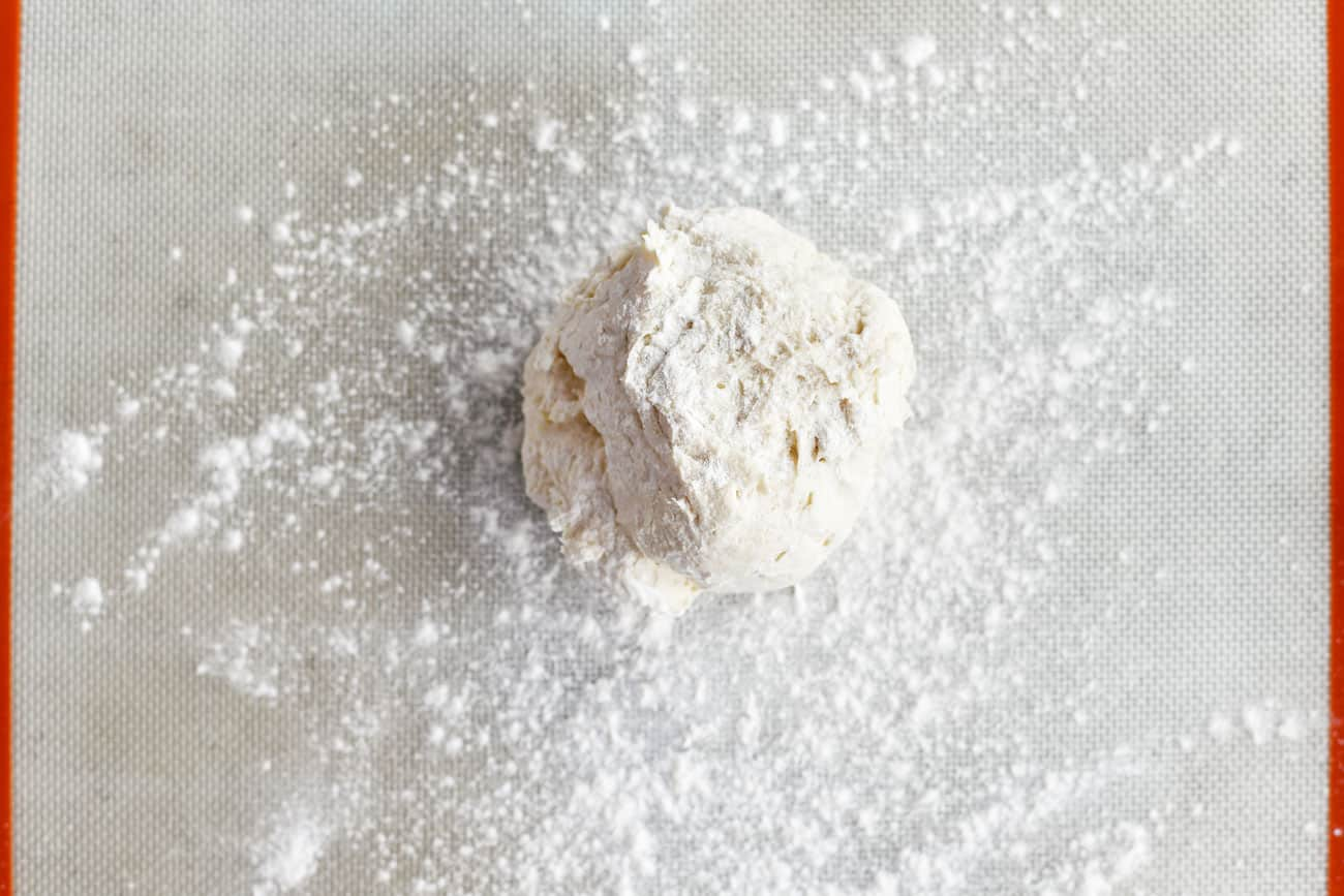 ball of two ingredient dough on a floured surface