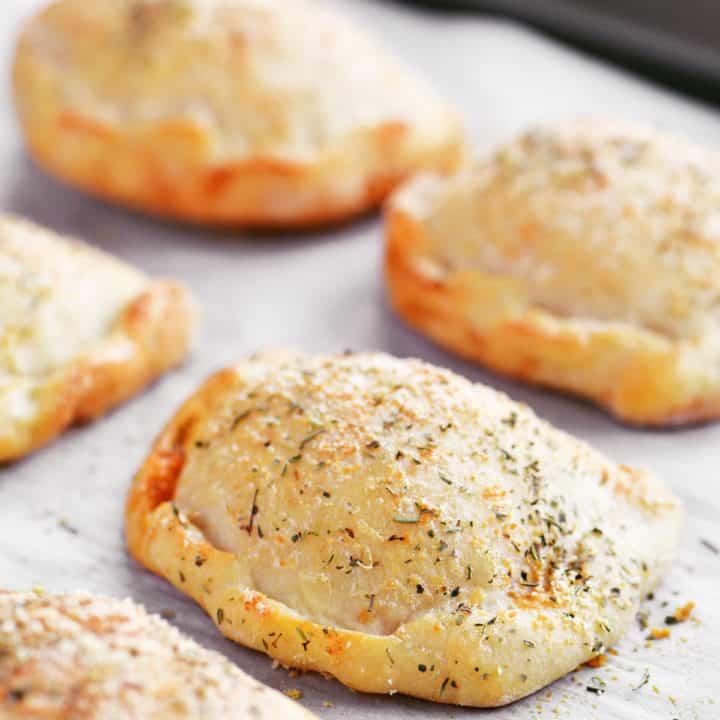 two ingredient dough calzones on baking sheet