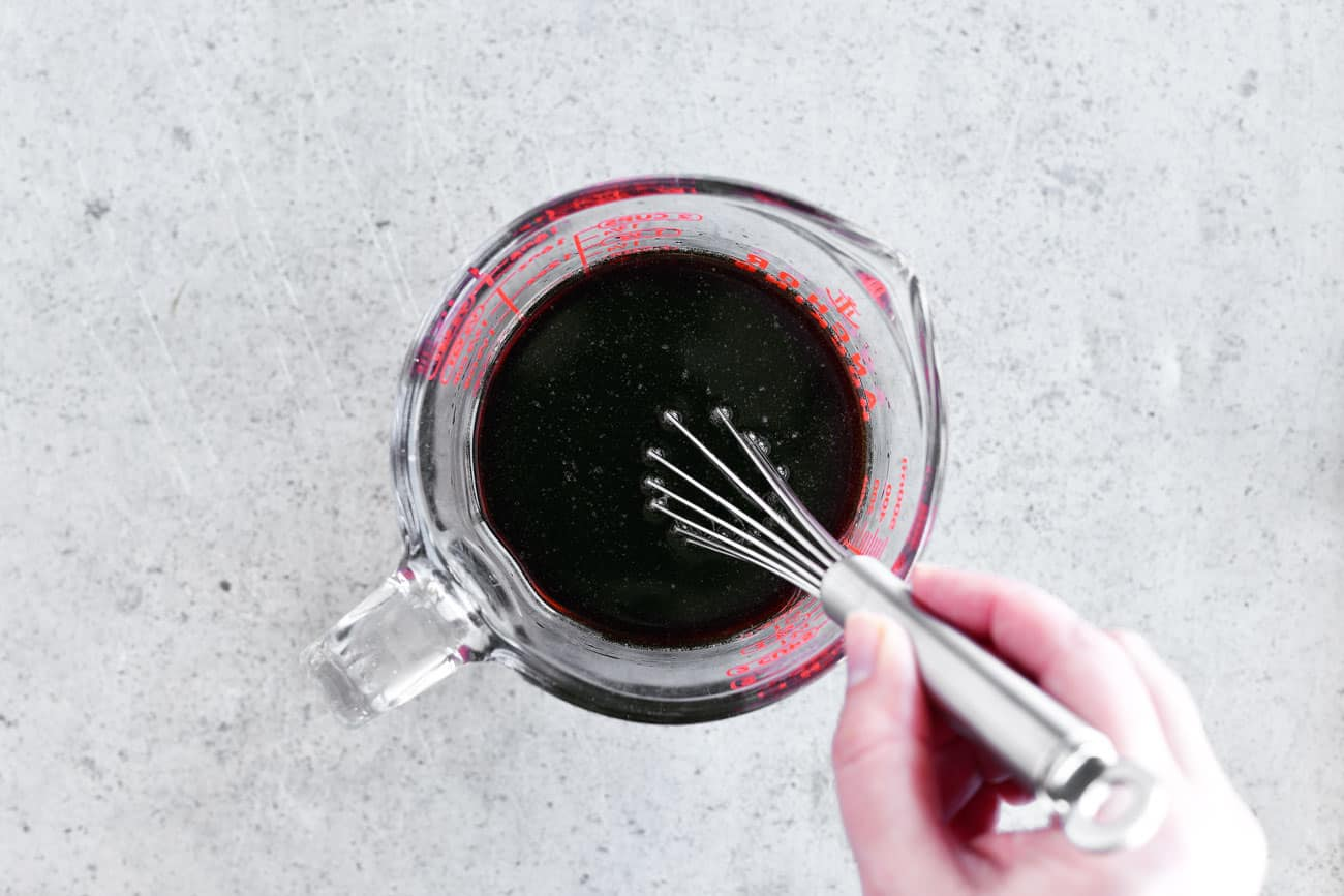 whisking soy sauce mixture in bowl