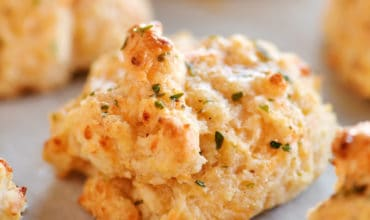cheddar biscuit with butter and seasonings