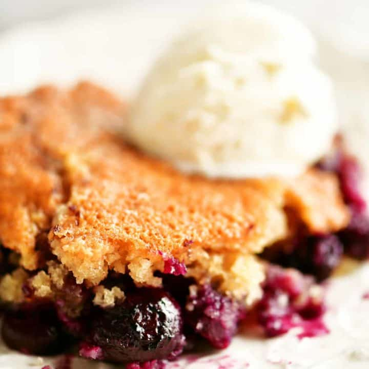 slice of blueberry cobbler with ice cream on top