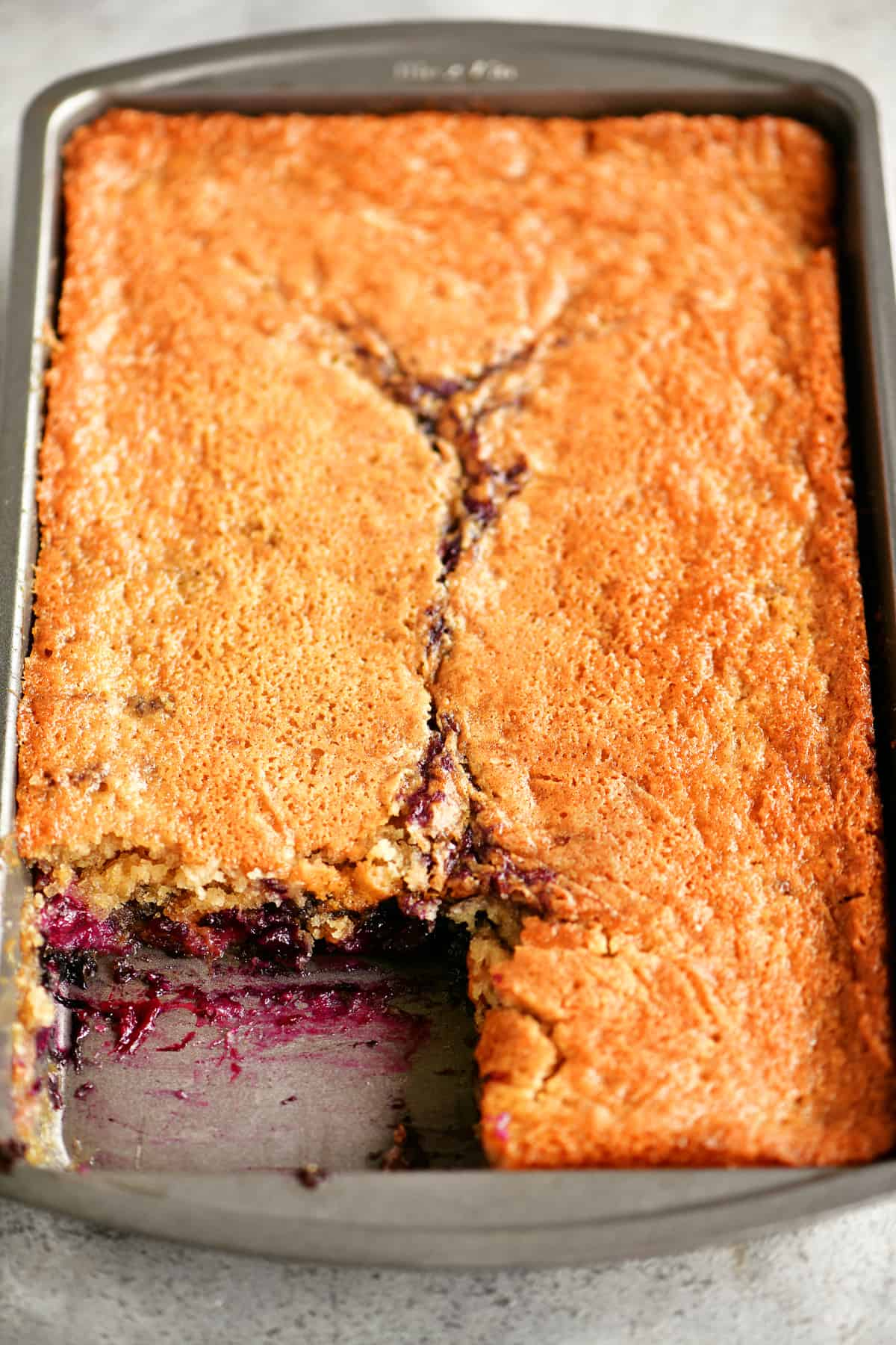 pan of blueberry cobbler with a slice removed