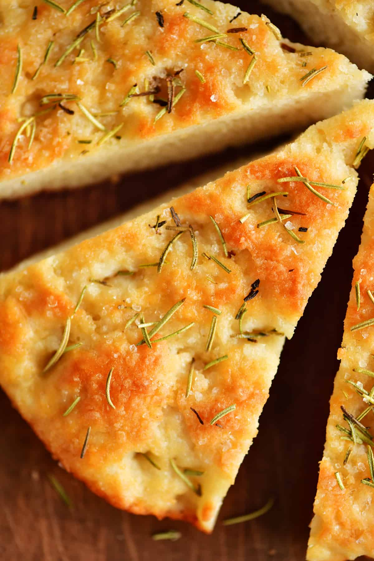 top view of a slice of baked rosemary focaccia bread