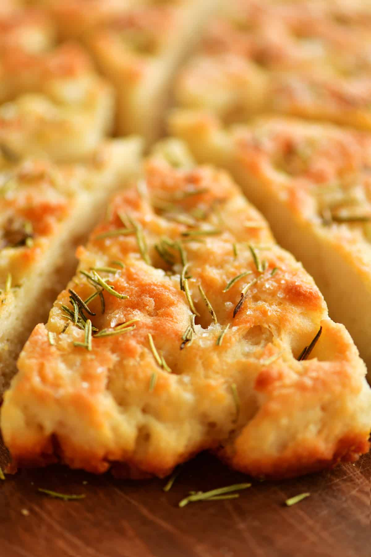 slice of two ingredient dough focaccia bread with rosemary on top