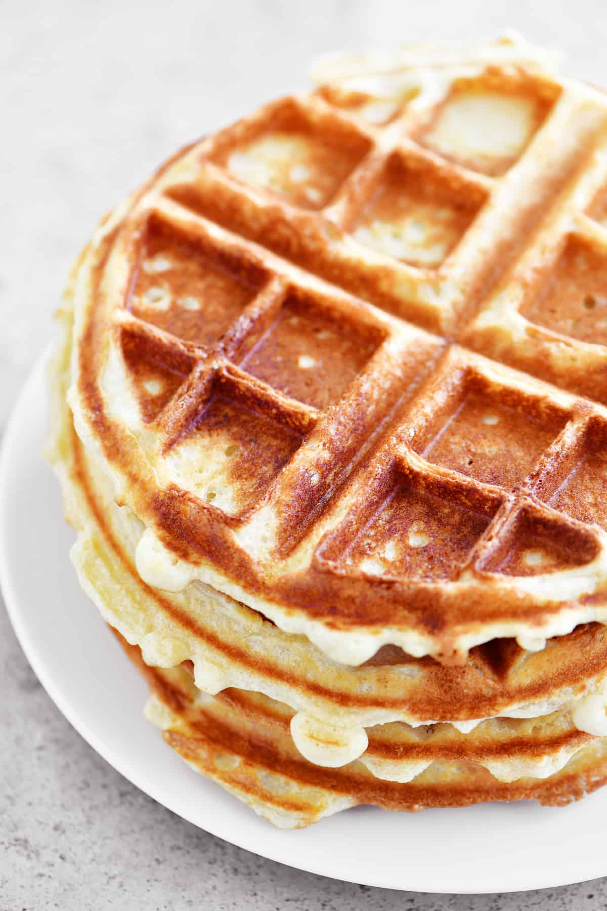 stack of waffles on a white plate