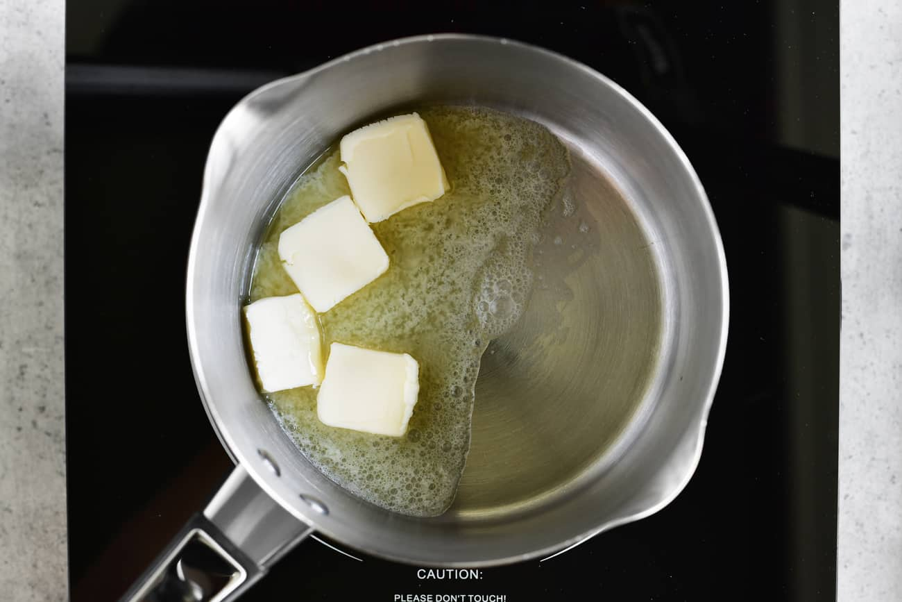cubed butter melting in a saucepan