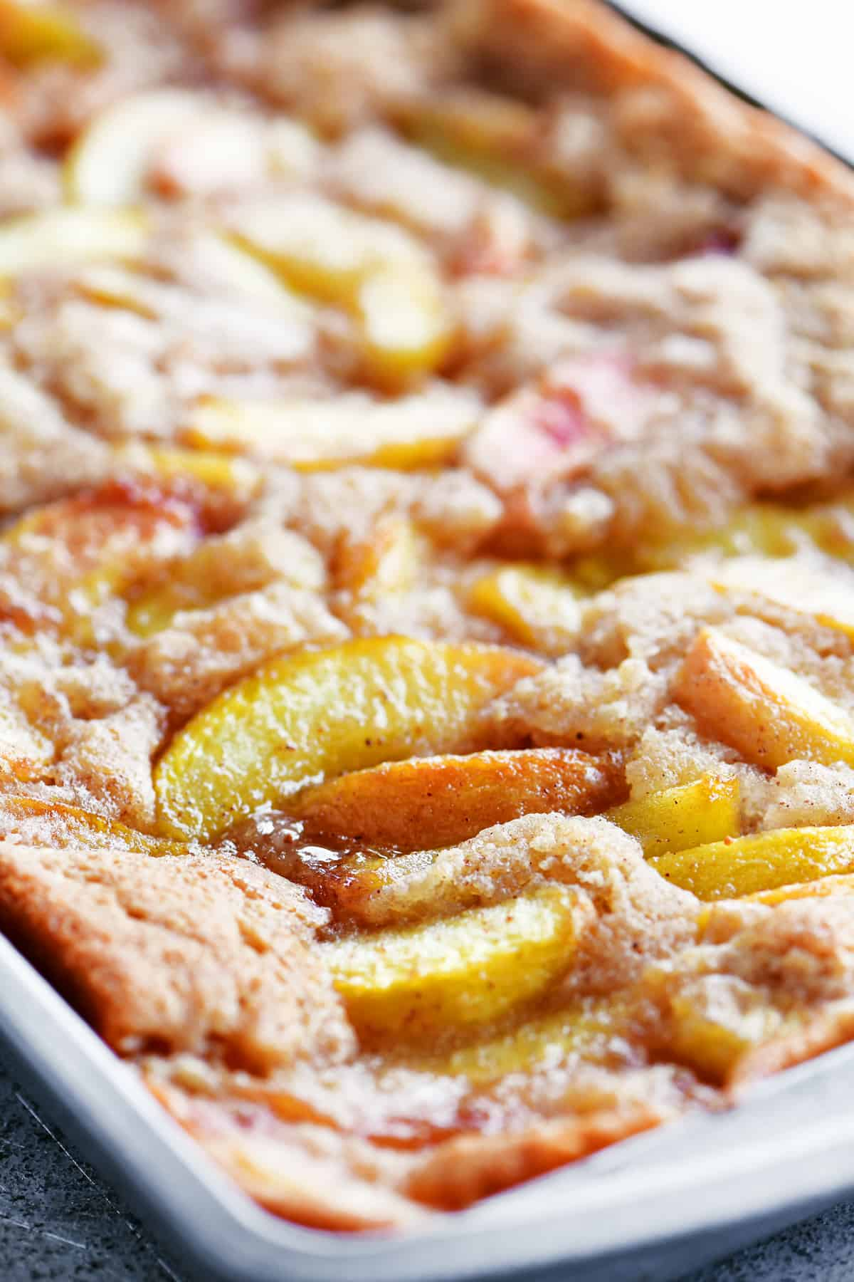 baked peach cobbler in pan
