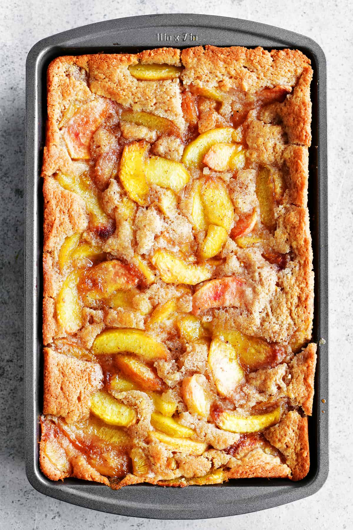 pan of peach cobbler with bisquick