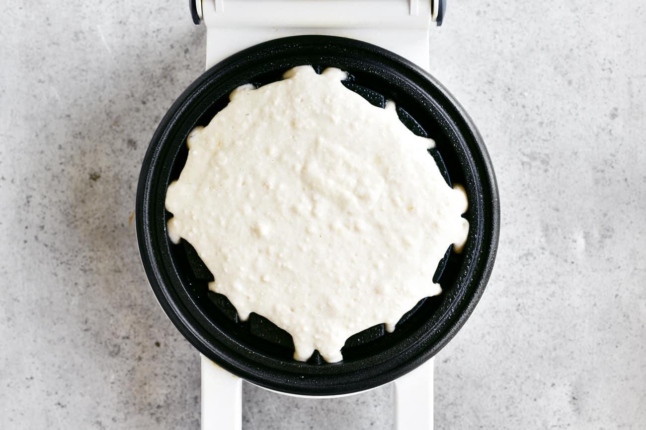 waffle batter on waffle iron