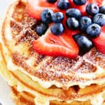 berries on a stack of bisquick waffles