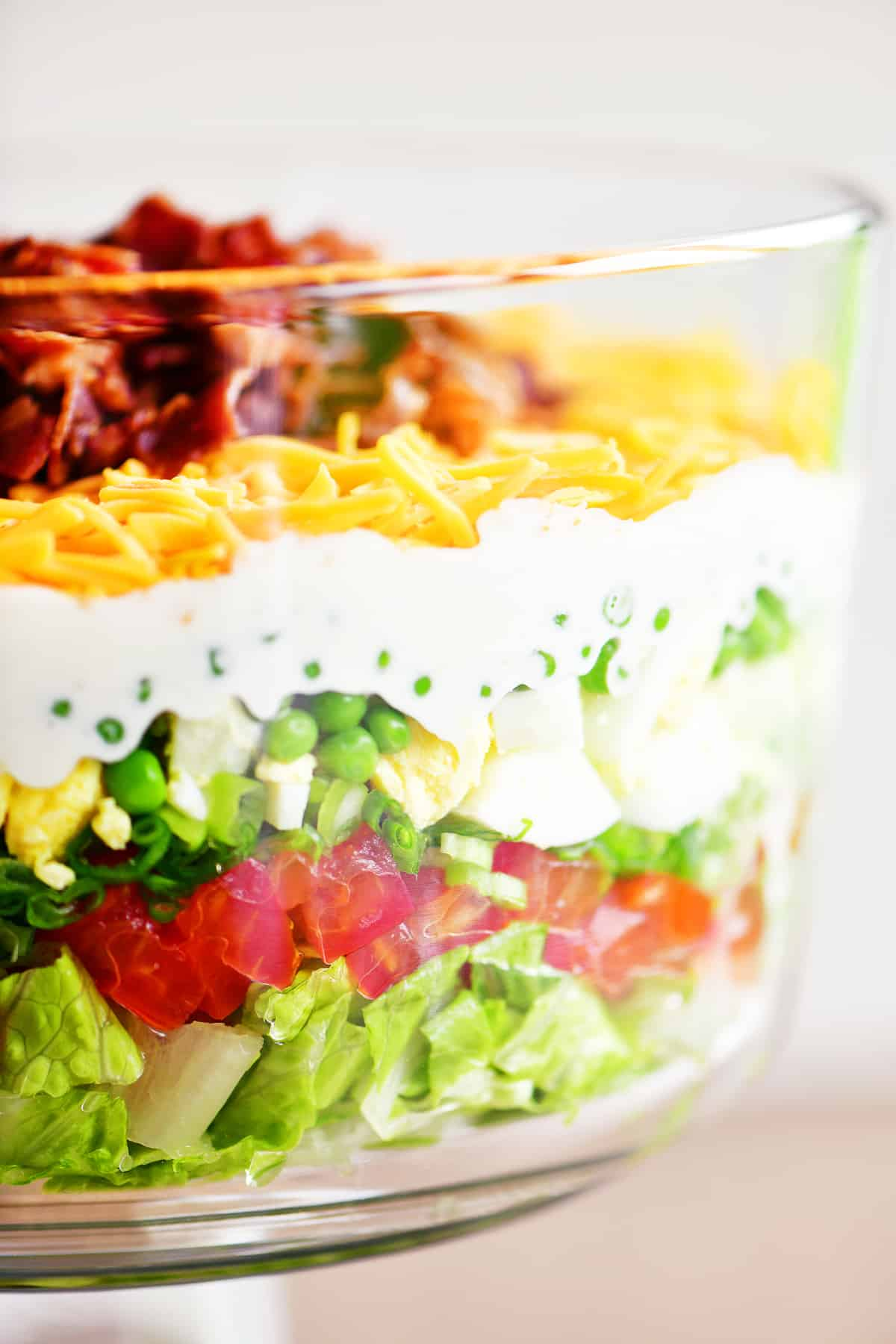 seven layer salad in glass bowl