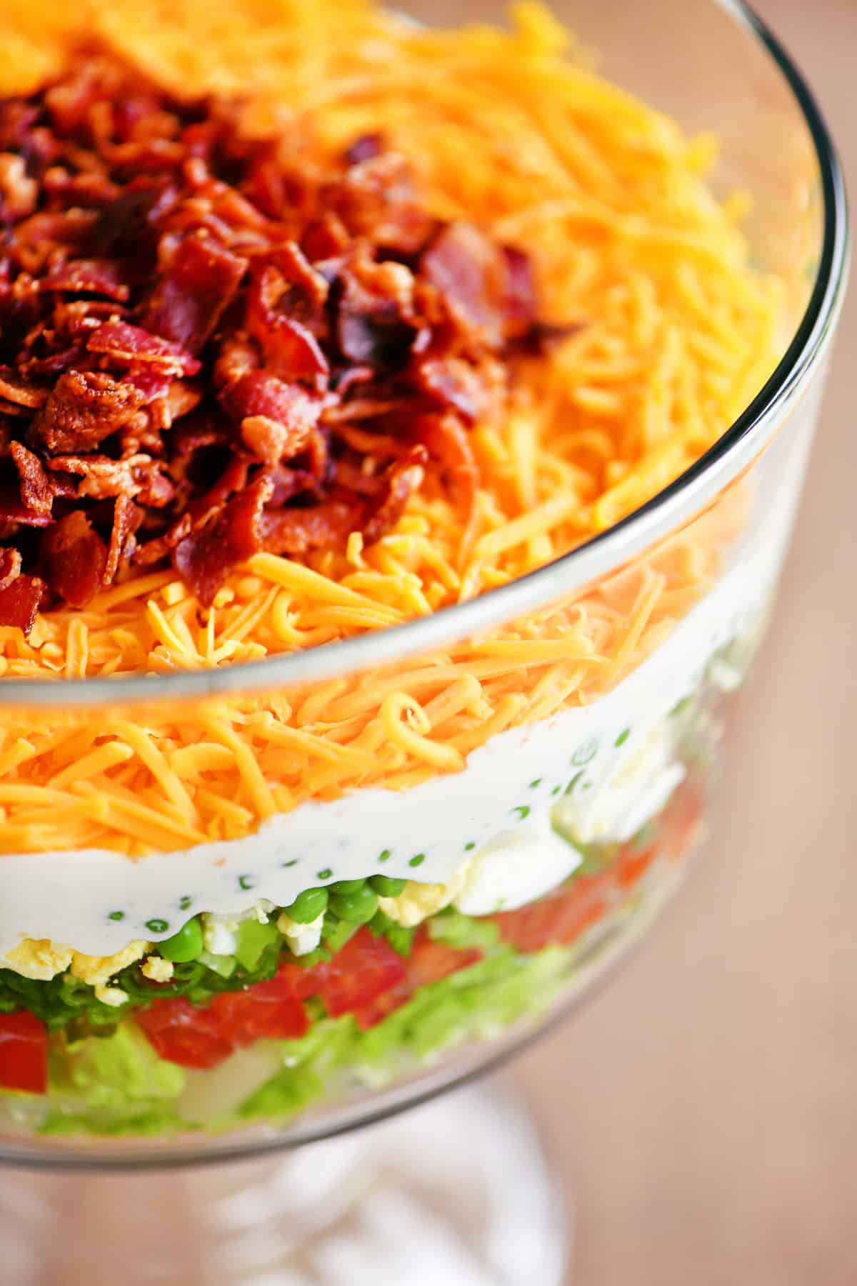 shredded cheddar and bacon on top of salad