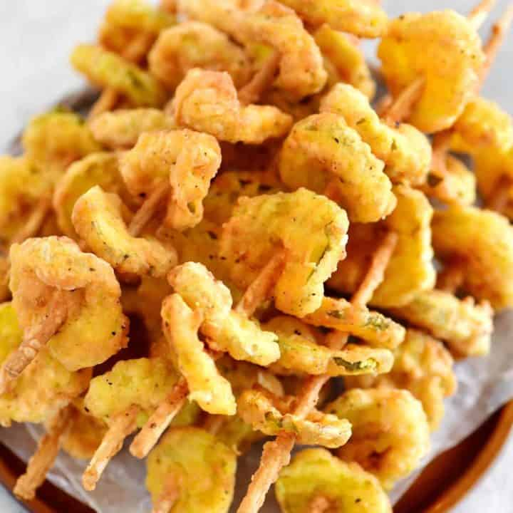 stack of fried pickles on a plate
