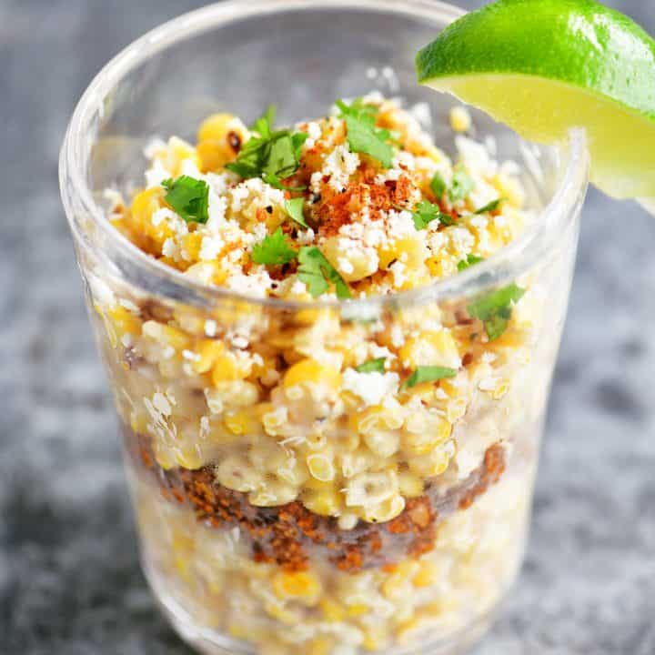 corn in a cup with lime wedge