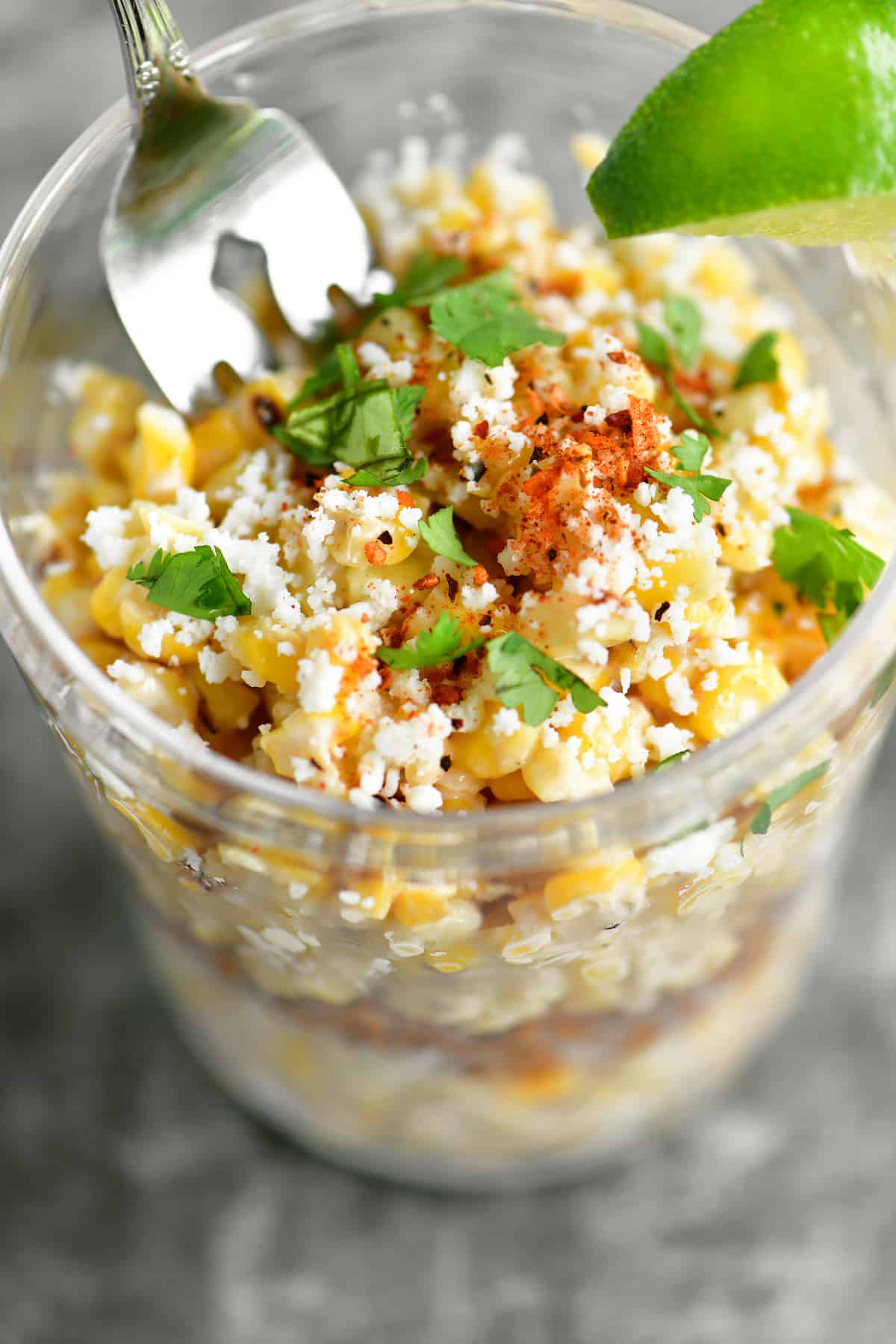 fork in a cup of mexican street corn salad