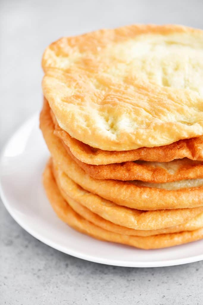 fried crusts in a stack on a white plate