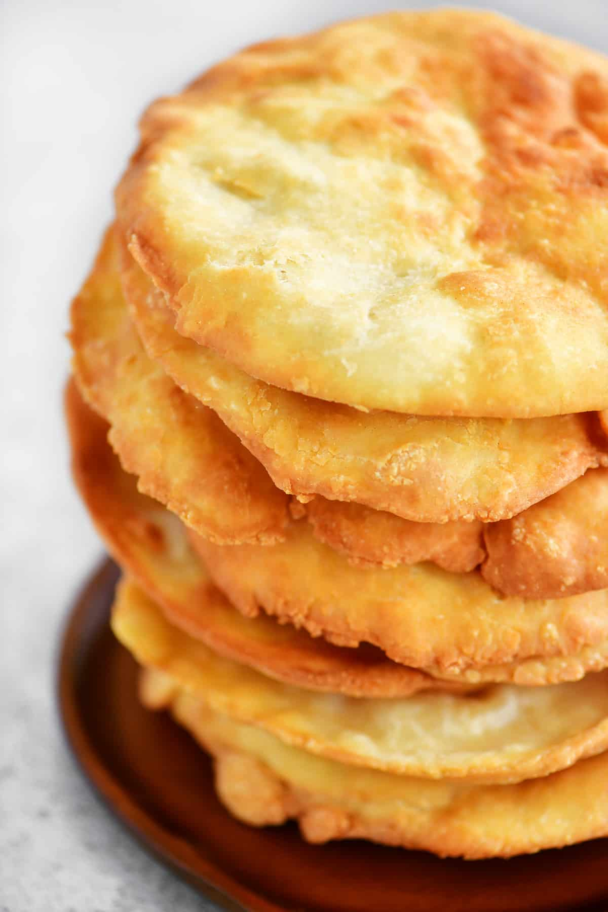 stack of fry bread on a wooden plate