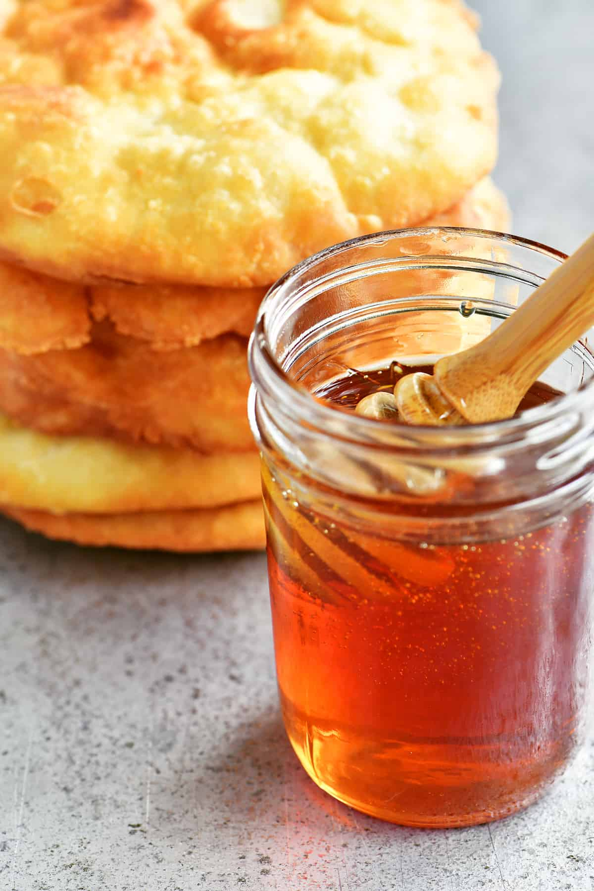 honey dipper in a jar of honey