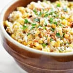 mexican street corn salad in a brown bowl