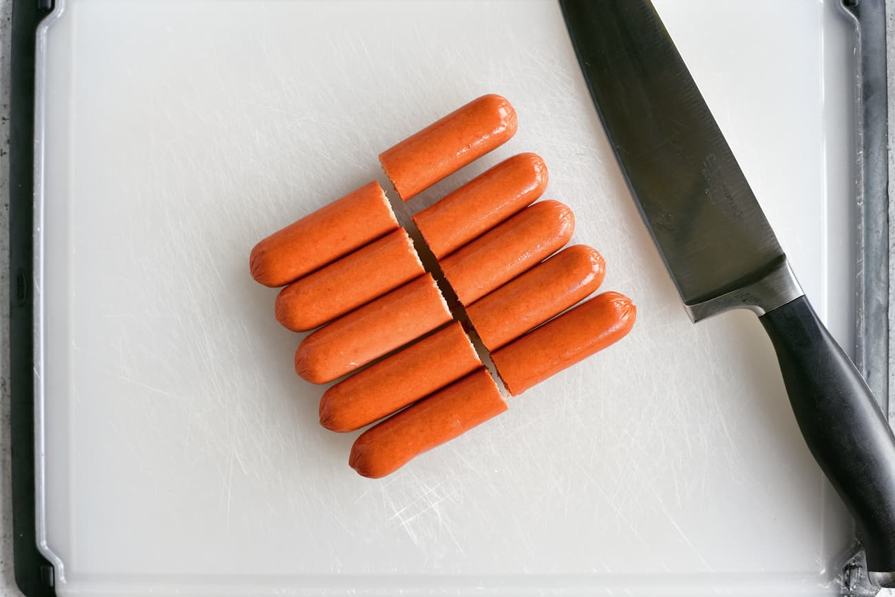 cutting hot dogs in half
