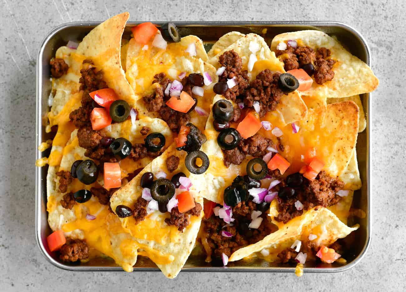add olives and onions to nachos