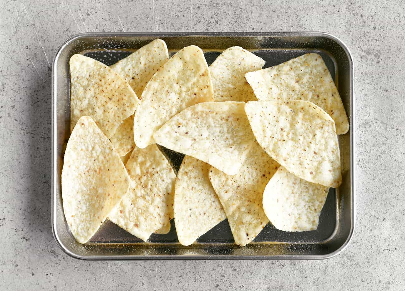 tortilla chips on a silver tray