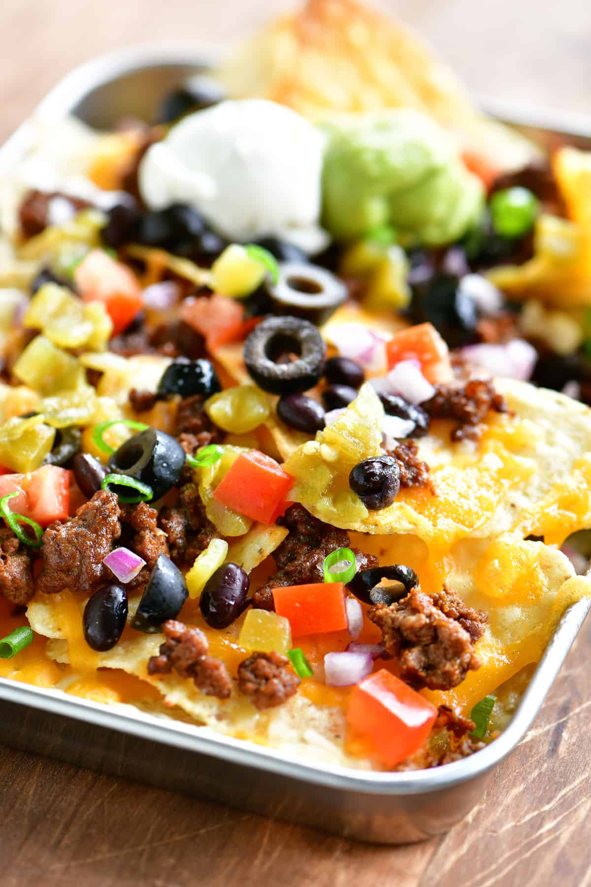 a close up photo of nachos on a tray