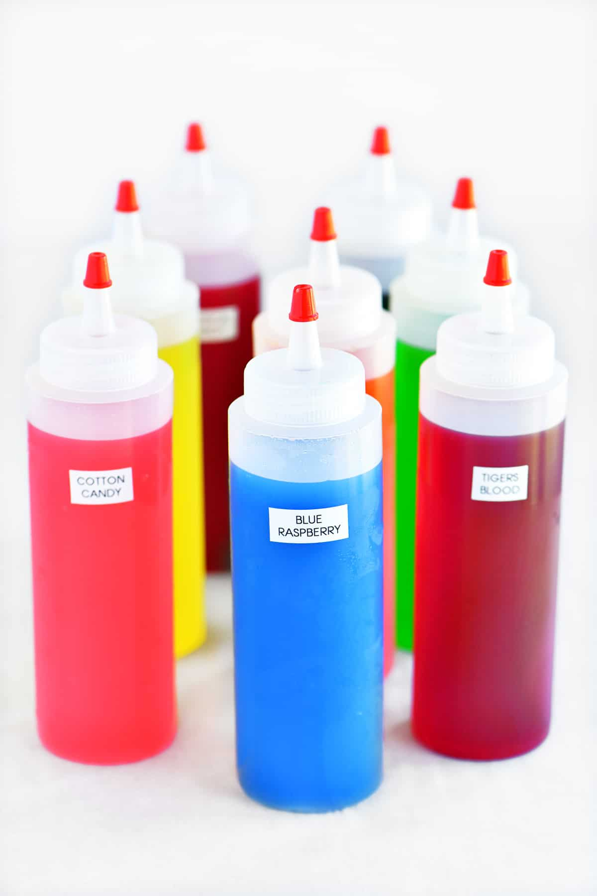 brightly colored bottles of snow cone syrups